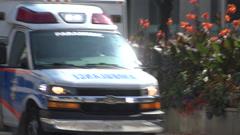 Toronto paramedic ambulance emergency service vehicle, flashing lights, siren - stock footage