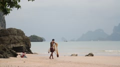 Ao Nang, Krabi Province, Thailand. Fisherman with a child Stock Footage