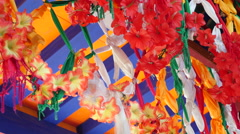 Colourful Floral Decorations hanging From An Archway Stock Footage