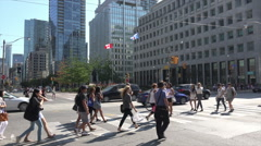Stock Video Footage of Business people and tourists walk across the street, Toronto, Canada