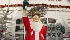 Funny Santa Claus In Front Of A Restaurant, In The Position Of Statue Of Liberty - stock footage