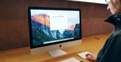 Stock Video Footage of Woman testing new iMac retina display  with the new Apple Keyboard and Apple