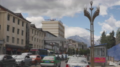 Traffic Moving Along The Streets In The Town Of Lijiang Stock Footage