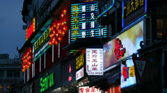 Colourful Chinese Neon Advertising Signs On Shops In Lijiang China At Night - stock footage