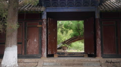 A Very Old Ancient Chinese Wood Building Door With At Dabaoji Palace Lijiang - stock footage