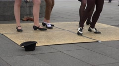 Synchronous young women tap dance in outdoor street event. 4K Stock Footage