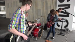 Wild boy rock group play for viewers on street music day. 4K Stock Footage
