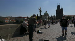 Man playing an oboe on Charles Bridge in Prague Stock Footage