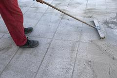 Install polymeric sand by brooming Stock Photos