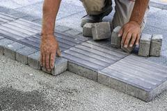 Installing tactile paving Stock Photos