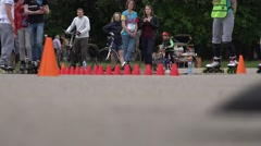 Close up of skater ride onefoot slalom element around red cone . 4K Stock Footage