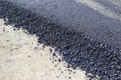 Stock Photo of New hot fresh layer of asphalt