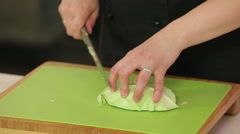 Chef cutting cabbage Stock Footage