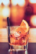 Glass of spritz aperitif aperol cocktail with orange slices and ice cubes on  Stock Photos
