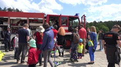 Parents with kids around military emergency fire fighter truck. 4K Arkistovideo