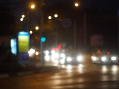 Defocused lights on the stream of cars and traffic lights Stock Photos