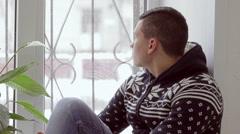 Sad man sitting on the window Stock Footage