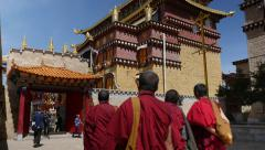 Tibetan Monks Walking In The Ganden Sumtsenling Monastery Yunnan Province China Stock Footage