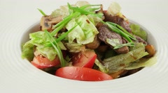 Warm salad with veal and roasted mushrooms in white plate Stock Footage