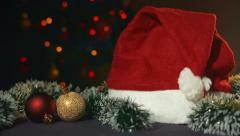 Cap of Santa Claus and Christmas toys Stock Footage