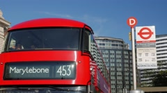 London Bus arrives at bus stop Stock Footage