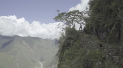 Tree and Hikers on Side of Cliff in Peru Stock Footage