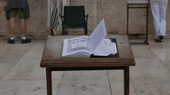 Flapping Pages of a Prayer Book at Western Wall Stock Footage