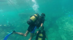 Divers In Shallow Waters Stock Footage