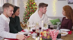 Man handing a christmas present to his girlfriend 4k Stock Footage