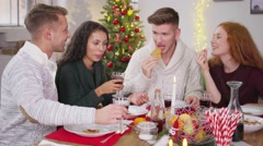 Four adults celebrating christmas at home 4k Stock Footage