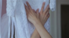 Hands girl in a wedding dress slip - stock footage