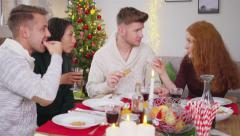 Friends enjoying christmas dinner together Stock Footage