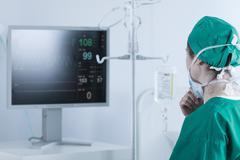 Surgeon analysing bodily functions Stock Photos