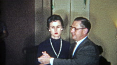 1956: Womanizing man dancing flirting with 3 different women in 1 night. Stock Footage