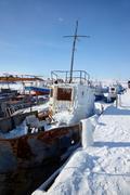 Old frozen ships in the port of Olkhon island on siberian lake Baikal Stock Photos