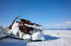 Old frozen ship on the bank of Olkhon island on lake Baikal - stock photo