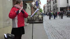 Poor girl play with flute in street for money. 4K Stock Footage