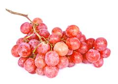 Bunch of red fresh grapes with water drops - stock photo
