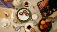 Family table gathering with tea and muffins breakfast Stock Footage