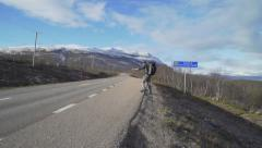 Backpacker Male Travel Model Failed Hitchhike Attempt in Sweden - stock footage