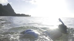 Model Snorkels in Beautiful Bay in Hawaii during Sunset Stock Footage