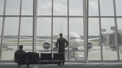 Model Stares at Airplane through Window - stock footage