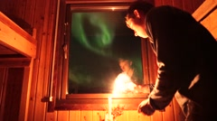 Northern Lights Outside the Window of a Candle Lit Cabin - stock footage