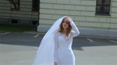 Beautiful bride walking in the park wind dispels her hair Stock Footage