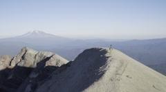 Trekker Camera Man Walks Across Volcano Mountain Ridge Stock Footage