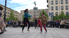 Happy young people in pairs dance lindy hop in street. 4K Stock Footage