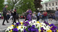 Young active people in pairs dance lindy hop in city square. 4K Stock Footage