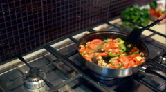 Cooking mushrooms with vegetables in a frying pan Stock Footage