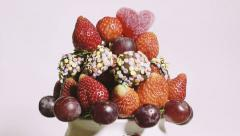 Close-up of delicious fruit bouquet spinning on a white background - stock footage