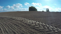 Freshly plowed  farm field in autumn with tractor traces. Timelapse 4K Stock Footage